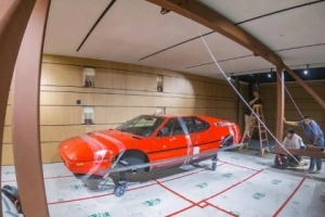 A BMW Collector Decorates His Garage Wall With 2 Wrecked BMW M1 Sportcars (Photos)